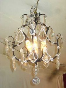 AUX MAINS DE BRONZE -  - Chandelier