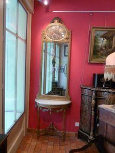Art & Antiques - console en bois doré louis xvi et son trumeau d'o - Consolle