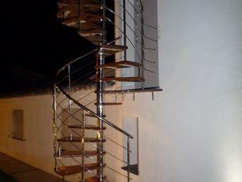 TRESCALINI - spiro : escalier colima�on inox et bois - Scala A Chiocciola